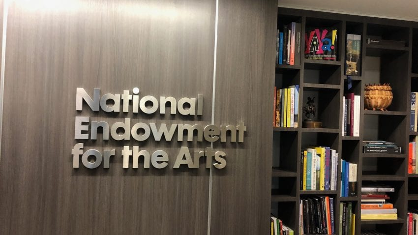 Brown wall with National Endowment for the Arts