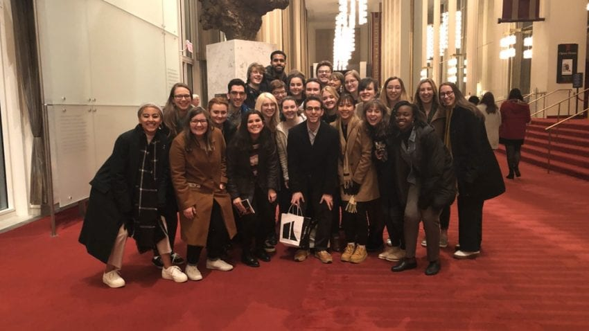 The St. Olaf group poses for a photo in the Kennedy Center. A statue of John F. Kennedy sits behind the group.