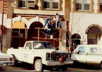 Workers outside renovating.