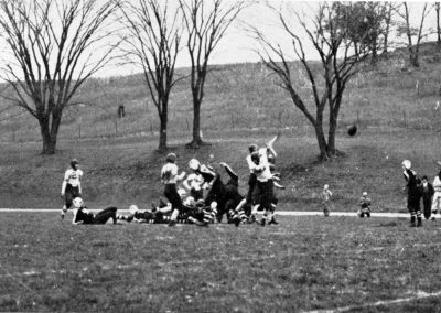 Playing football at bottom of Thorson Hill.