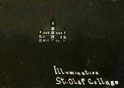 Old Main illuminated.