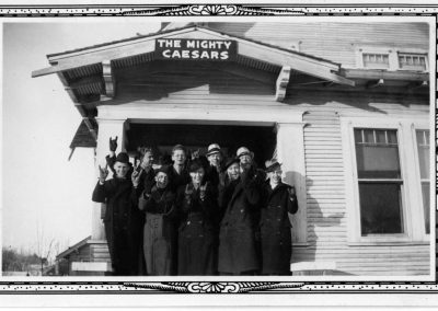 The Mighty Caesars pose on the front steps of house.