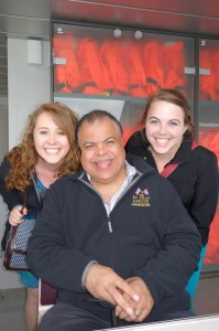 Katharine Jenks '13 and Kelsey Hall '13 take a moment to pose with Anton Armstrong '78, conductor of the choir, during the Haugesund to Bergen ferry ride.