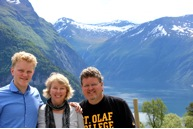 """The Mountains Tower"" over Jeff ('84) and Heidi Christensen ('85) Haines with son Jon Erik ('14)."