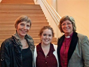 Ellie Mears '13, smiles with the Mayor and Bishop of Molde during the concert reception.