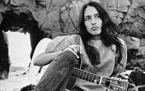 Joan Baez with her guitar